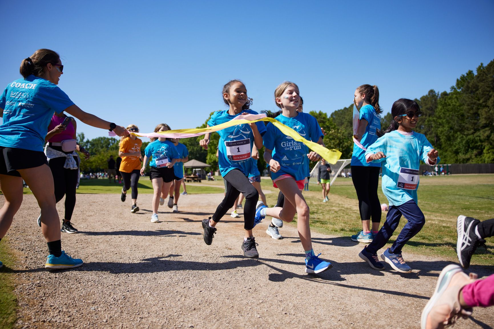 Girls crossing the finish line - Girls on the Run